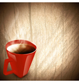wooden background with red cup of coffee vector image