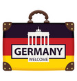 suitcase in colors of german flag vector image vector image