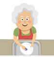elderly woman cleaning the dishes with a sponge vector image vector image