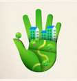 green paper cut hand with eco friendly house vector image