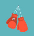 red boxing gloves hanging on nail of wall vector image vector image