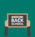 hand holding sign back to school chalkboard vector image vector image