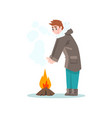 man warming his hands by the fire outdoor leisure vector image