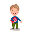 cute happy boy standing and holding book vector image vector image