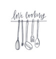 love cooking text written with elegant font and vector image vector image