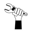 hand holding wrench tool icon image vector image vector image