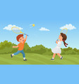 kids play tennis in summer park excited boy girl vector image vector image