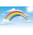 rainbow in sky with clouds vector image