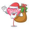 santa with gift ballon heart mascot cartoon vector image