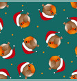 red robin bird santa claus on green background vector image vector image