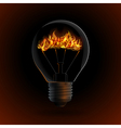 lightbulb with fire isolated on dark background vector image vector image