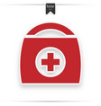 first aid kit medical help icon in red vector image vector image