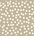 white dots on gold background vector image