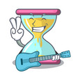 with guitar modern hourglass on the table cartoon vector image vector image