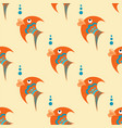 orange fish with blue ornament on a beige vector image vector image