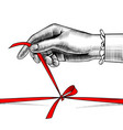 womans hand untying bow red ribbon vector image vector image