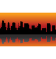 Silhouette of city with orange background vector image vector image