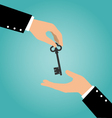 Business hand giving a house key to another hand vector image vector image