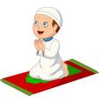 cartoon muslim boy praying on prayer rug vector image vector image