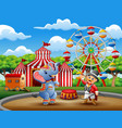 Circus ringmaster performs a trick along with elep