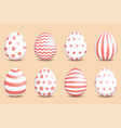 set realistic easter decorated eggs on coral vector image vector image