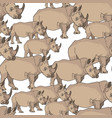 seamless background with rhinoceroses vector image