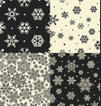 Seamless Snowflakes Patterns set vector image