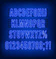 retro blue neon alphabet with numbers on dark vector image