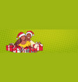 african american couple wearing santa hats hold vector image