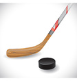 Hockey stick and hockey puck vector image vector image